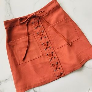 Lovers + Friends coral lace up mini skirt